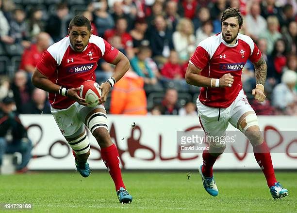 Taulupe Faletau of the Probables supported b y Josh Turnbull charges at the Possibles during the Wales Senior Trial between Probables v Possibles at...