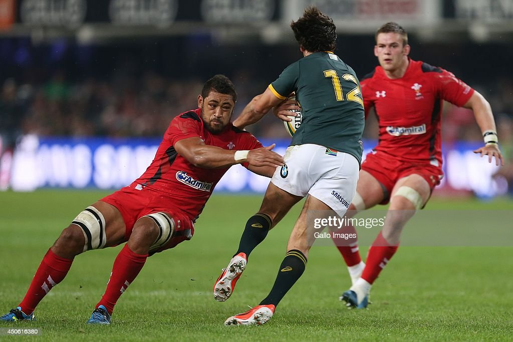 Taulupe Faletau of the Wales looking to make a tackle on Jan Serfontein of South Africa during the Incoming Tour match between South Africa and Wales at Growthpoint Kings Park on June 14, 2014 in Durban, South Africa.