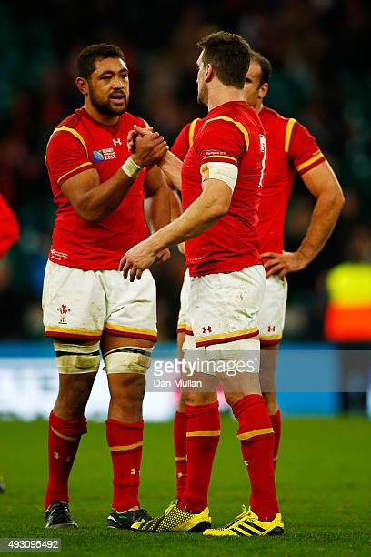 Taulupe Faletau of Wales and Sam Warburton of Wales shake hands during the 2015 Rugby World Cup Quarter Final match between South Africa and Wales at...