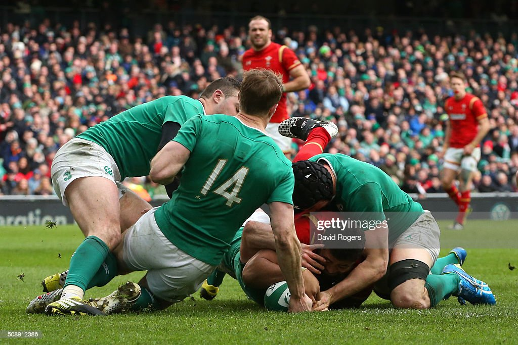 <a gi-track='captionPersonalityLinkClicked' href=/galleries/search?phrase=Taulupe+Faletau&family=editorial&specificpeople=12444794 ng-click='$event.stopPropagation()'>Taulupe Faletau</a> of Wales forces his way over the lineto score his team's first try during the RBS Six Nations match between Ireland and Wales at the Aviva Stadium on February 7, 2016 in Dublin, Ireland.