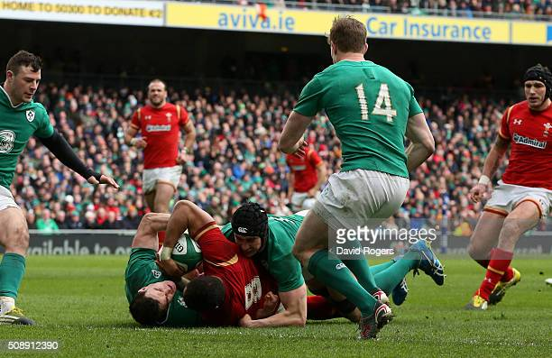 Taulupe Faletau of Wales forces his way over the lineto score his team's first try during the RBS Six Nations match between Ireland and Wales at the...