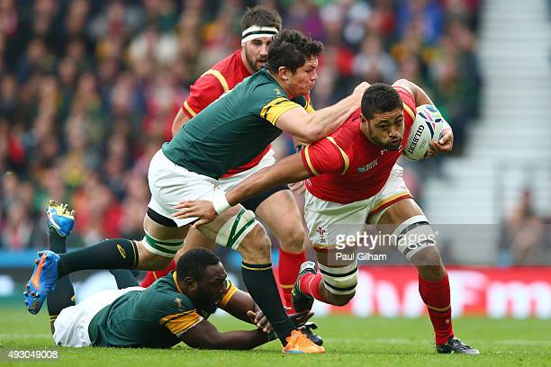 Taulupe Faletau of Wales is tackled by Francois Louw of South Africa and Tendai Mtawarira of South Africa during the 2015 Rugby World Cup Quarter...