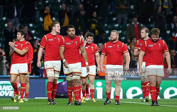 Taulupe Faletau of Wales looks dejected with team mates after the 2015 Rugby World Cup Quarter Final match between South Africa and Wales at...