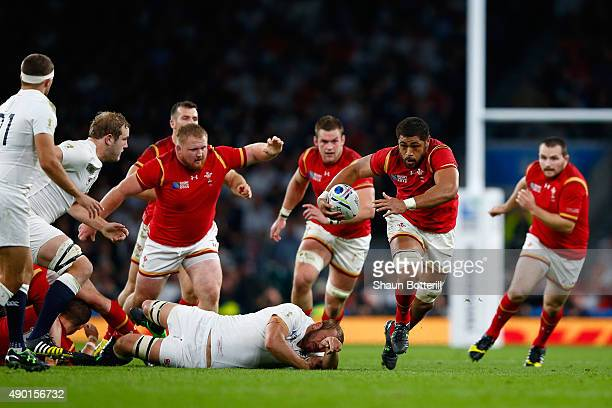 Taulupe Faletau of Wales makes a break during the 2015 Rugby World Cup Pool A match between England and Wales at Twickenham Stadium on September 26...
