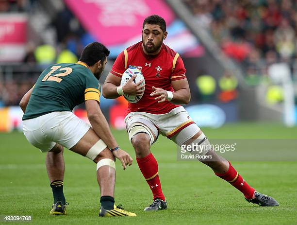 Taulupe Faletau of Wales takes on Damian De Allende of South Africa during the 2015 Rugby World Cup Quarter Final match between South Africa and...
