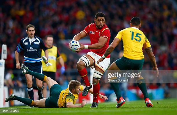 Taulupe Faletau of Wales takes on Drew Mitchell and Israel Folau of Australia during the 2015 Rugby World Cup Pool A match between Australia and...