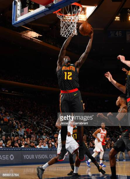 Taurean Prince of the Atlanta Hawks goes up for the rebound against the New York Knicks at Madison Square Garden on December 10 2017 in New York New...