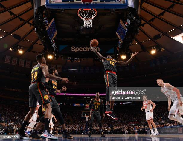 Taurean Prince of the Atlanta Hawks grabs the rebound against the New York Knicks at Madison Square Garden on December 10 2017 in New York New York...
