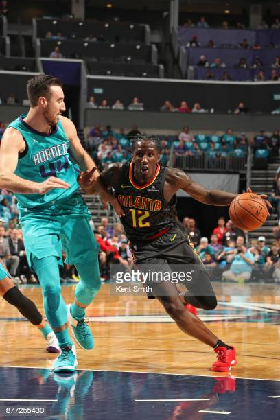 Taurean Prince of the Atlanta Hawks handles the ball against the Charlotte Hornets on October 20 2017 at Spectrum Center in Charlotte North Carolina...