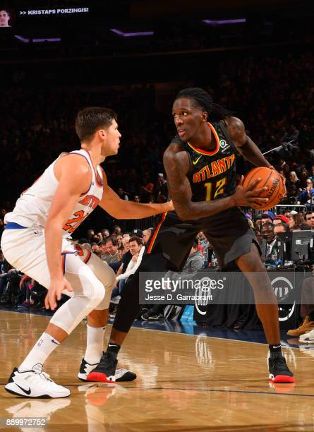 Taurean Prince of the Atlanta Hawks looks to pass the ball against the New York Knicks at Madison Square Garden on December 10 2017 in New York New...