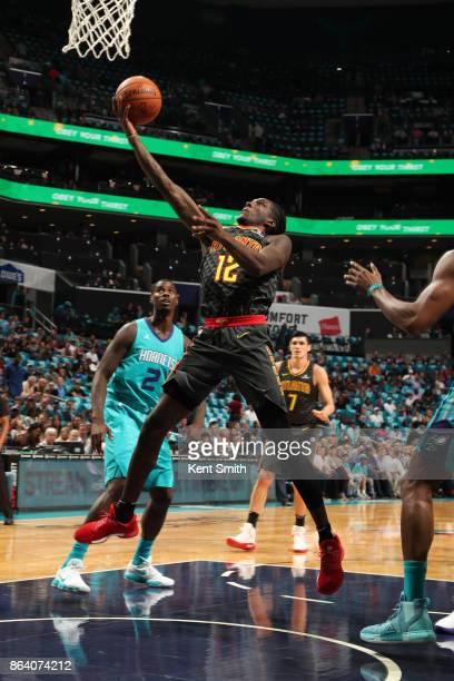 Taurean Prince of the Atlanta Hawks shoots the ball during the game against the Charlotte Hornets on October 20 2017 at Spectrum Center in Charlotte...