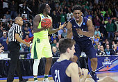 Taurean Prince of the Baylor Bears and Brandon Sherrod of the Yale Bulldogs react to a call in the second half of their game during the first round...
