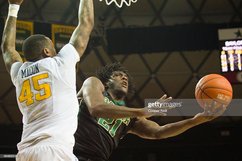 Taurean Prince of the Baylor Bears drives to the basket against Elijah Macon of the West Virginia Mountaineers on February 28 2015 at the Ferrell...