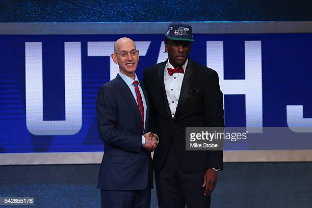 Taurean Prince poses with Commissioner Adam Silver after being drafted 12th overall by the Utah Jazz in the first round of the 2016 NBA Draft at the...