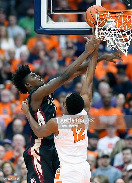 Taurean Thompson of the Syracuse Orange is called for a foul while attempting to block the shot of Jonathan Isaac of the Florida State Seminoles...