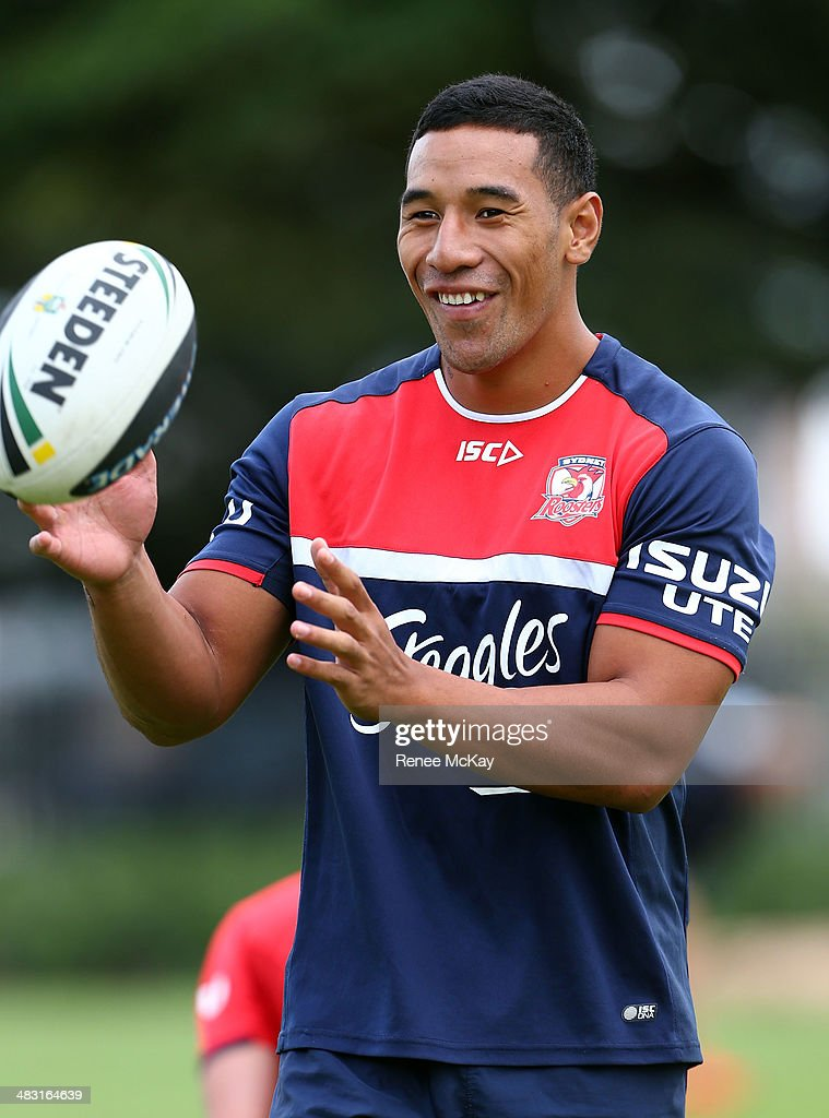 Tautau Moga catches the ball during a Sydney Roosters NRL training session at Kippax Lake on April 7, 2014 in Sydney, Australia.