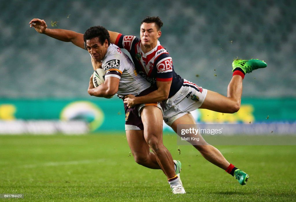 Tautau Moga of the Broncos is tackled by Joseph Manu of the Roosters during the round 13 NRL match between the Sydney Roosters and the Brisbane Broncos at Allianz Stadium on June 3, 2017 in Sydney, Australia.