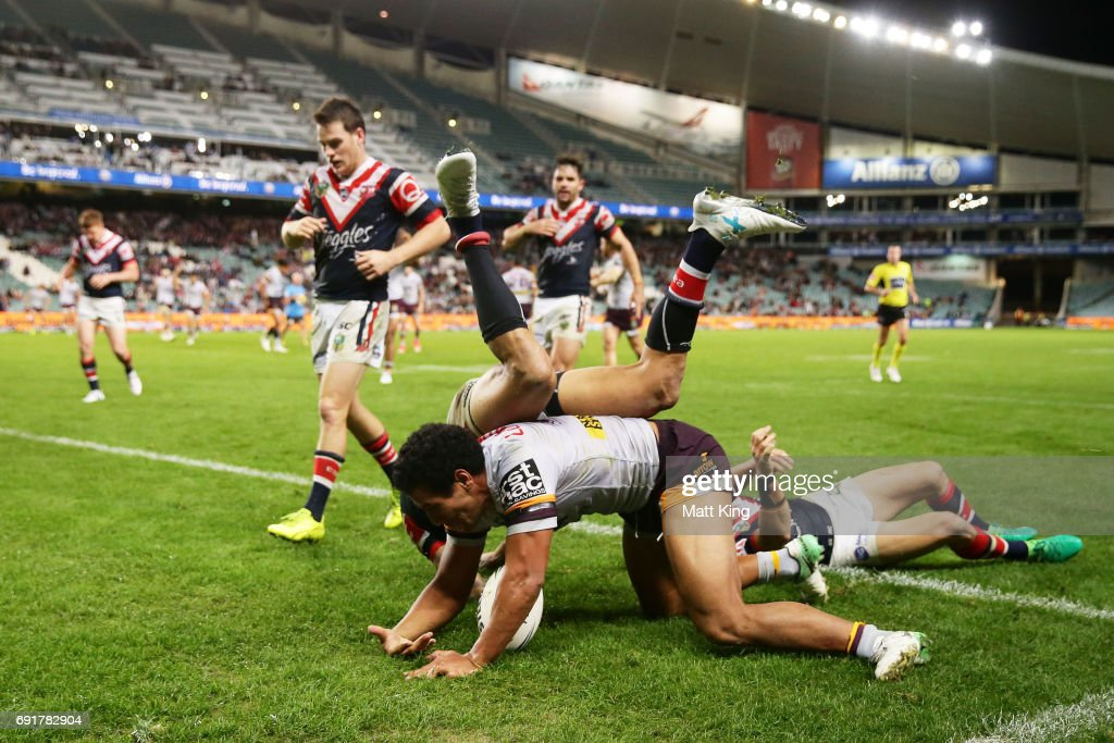 Tautau Moga of the Broncos scores the final try as Blake Ferguson of the Roosters defends during the round 13 NRL match between the Sydney Roosters and the Brisbane Broncos at Allianz Stadium on June 3, 2017 in Sydney, Australia.