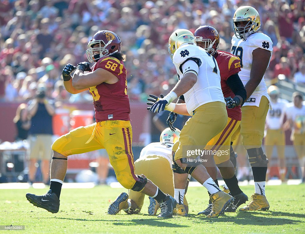 J.R. Tavai #58 of the USC Trojans reacts to his sack of <a gi-track='captionPersonalityLinkClicked' href=/galleries/search?phrase=Everett+Golson&family=editorial&specificpeople=9688386 ng-click='$event.stopPropagation()'>Everett Golson</a> #5 of the Notre Dame Fighting Irish during the second quarter at Los Angeles Memorial Coliseum on November 29, 2014 in Los Angeles, California.