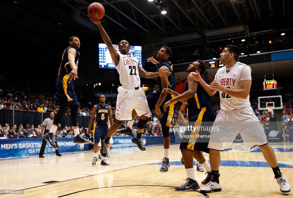 Tavares Speaks of the Liberty Flames drives for a shot attempt against North Carolina AT Aggies in the second half during the first round of the 2013...