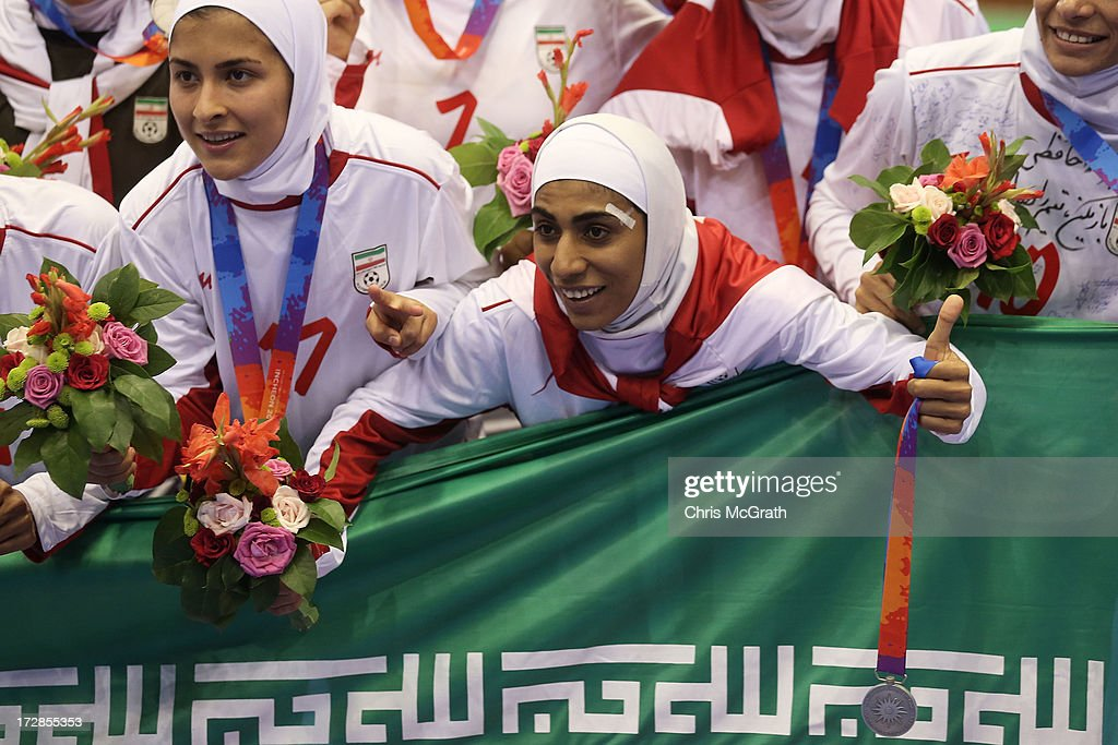 Tavasoli Sis Farzaneh #1 of Iran celebrates with her silver medal during the victory ceremony for the Women's Futsal Gold Medal match between Iran and Japan at Songdo Global University Campus Gymnasium during day seven of the 4th Asian Indoor & Martial Arts Games on July 5, 2013 in Incheon, South Korea.
