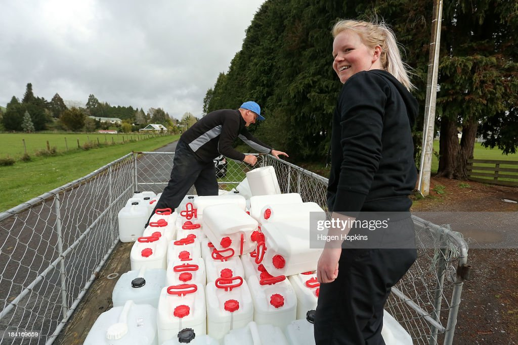 Tavia Goddard (R) and Ludek Vana of Ruapehu Alpine Lifts make water deliveries to residents on October 12, 2013 in Raetihi, New Zealand. Work has begun to flush a stream contaminated by a large diesel spill at Tongariro National Park. A tank from the Turoa Ski Field has leaked 15,000 litres of diesel into the Makotuku stream.