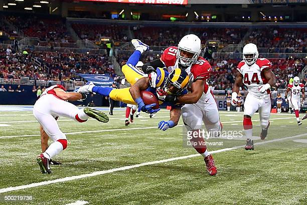 Tavon Austin of the St Louis Rams is tackled by Kevin Minter of the Arizona Cardinals in the first quarter at the Edward Jones Dome on December 6...