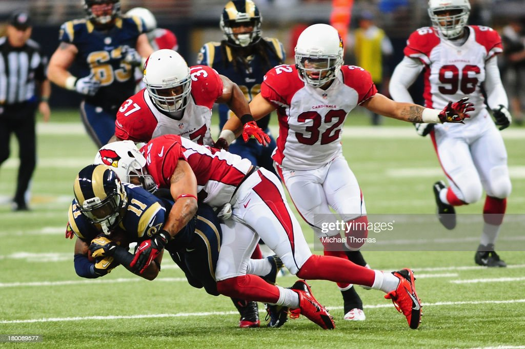 Tavon Austin #11 of the St. Louis Rams is tackled by Rashard Johnson #26 of the Arizona Cardinals on September 8, 2013 in St. Louis, Missouri.