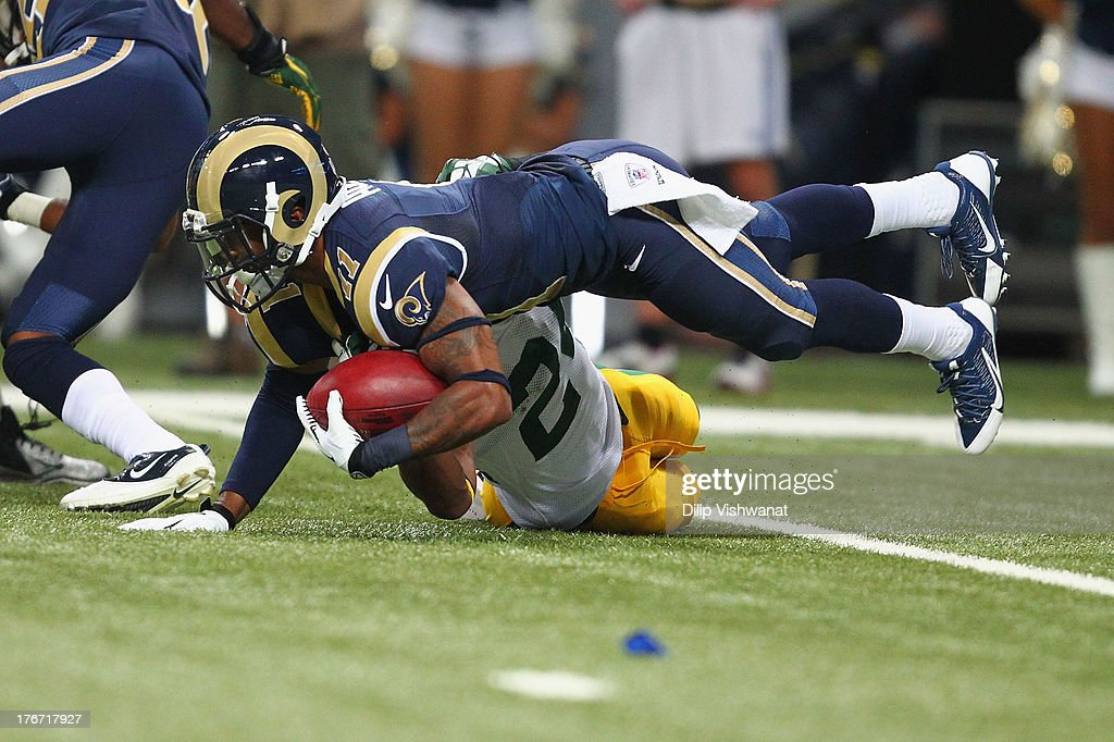 <a gi-track='captionPersonalityLinkClicked' href=/galleries/search?phrase=Tavon+Austin&family=editorial&specificpeople=6543303 ng-click='$event.stopPropagation()'>Tavon Austin</a> #11 of the St. Louis Rams is tackled on a kick-off return during a preseason game against the Green Bay Packers at the Edward Jones Dome on August 17, 2013 in St. Louis, Missouri.