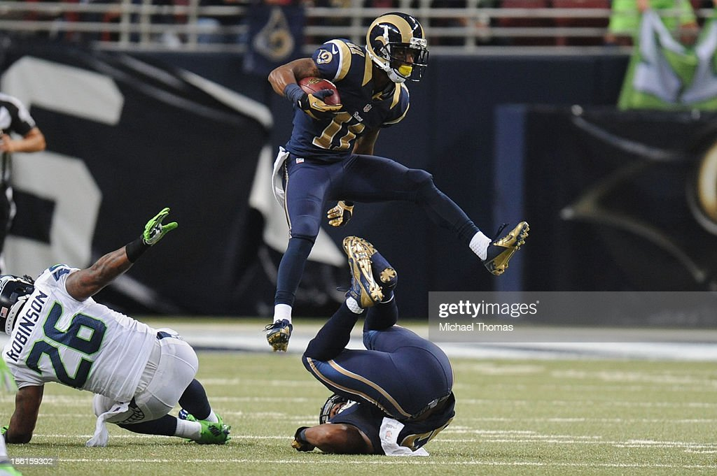 <a gi-track='captionPersonalityLinkClicked' href=/galleries/search?phrase=Tavon+Austin&family=editorial&specificpeople=6543303 ng-click='$event.stopPropagation()'>Tavon Austin</a> #11 of the St. Louis Rams leaps during a kick return in the third quarter against the Seattle Seahawks at the Edward Jones Dome on October 28, 2013 in St. Louis, Missouri.