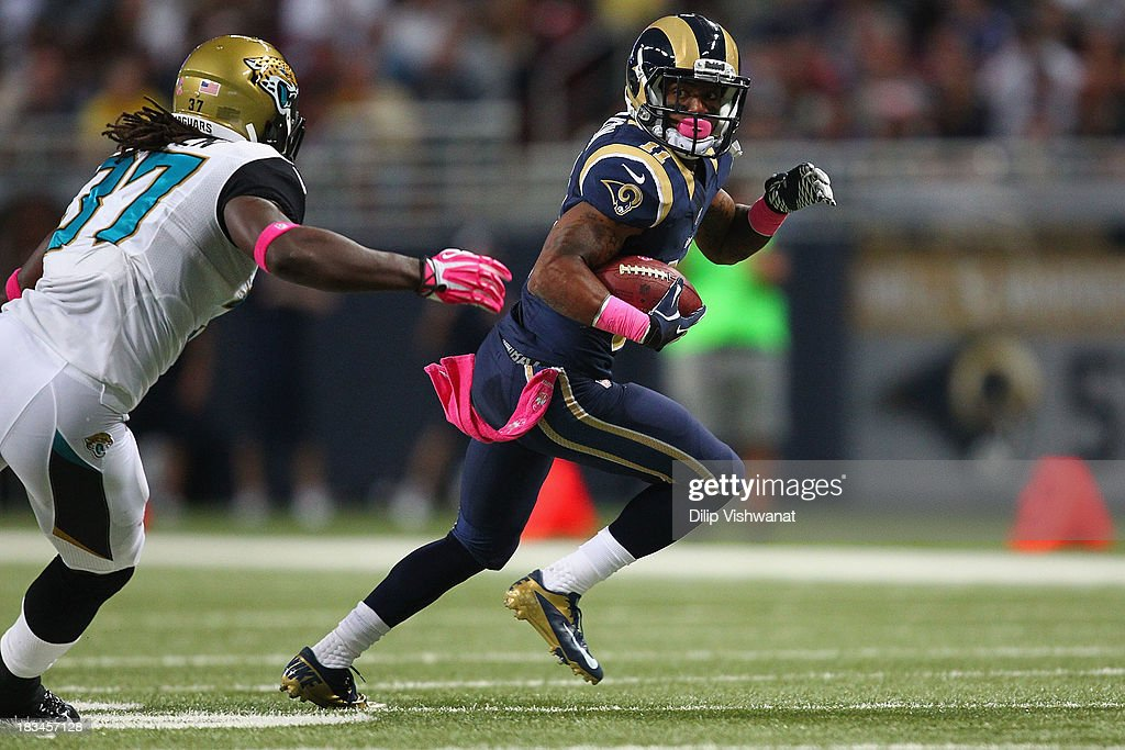Tavon Austin #11 of the St. Louis Rams looks to avoid being tackled after making a catch against John Cyprien #37 of the Jacksonville Jaguars at the Edward Jones Dome on October 6, 2013 in St. Louis, Missouri. The Rams beat the Jaguars 34-20.