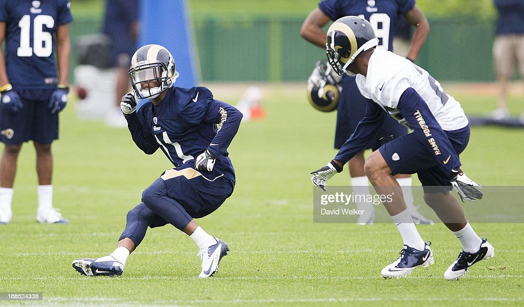 <a gi-track='captionPersonalityLinkClicked' href=/galleries/search?phrase=Tavon+Austin&family=editorial&specificpeople=6543303 ng-click='$event.stopPropagation()'>Tavon Austin</a> (11) of the St. Louis Rams makes a cut while performing a drill during the 2013 St. Louis Rams rookie camp at Rams Park on May 10, 2013 in Earth City, Missouri.