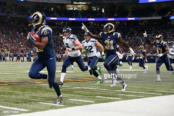 Tavon Austin of the St Louis Rams returns a punt for a touchdown in the third quarter against the Seattle Seahawks at the Edward Jones Dome on...