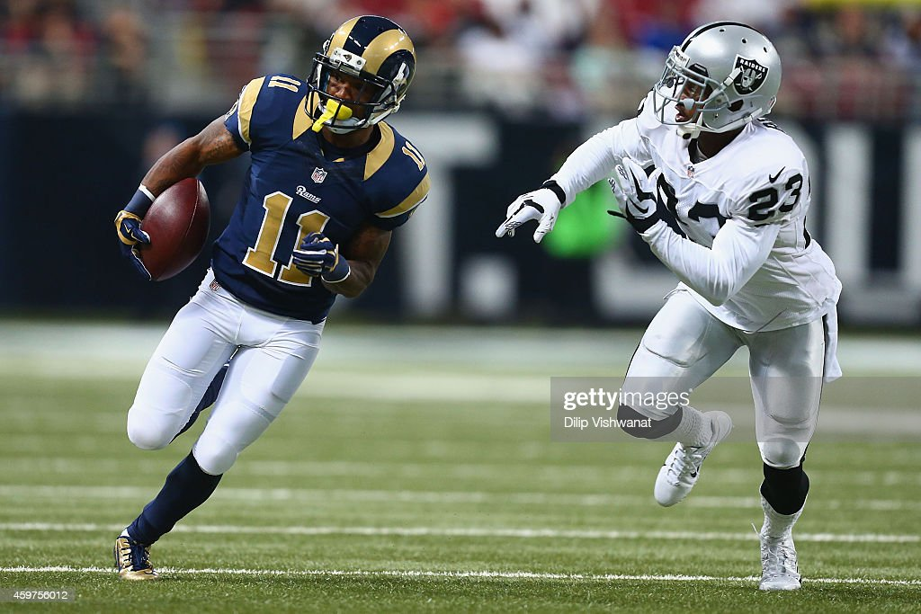 <a gi-track='captionPersonalityLinkClicked' href=/galleries/search?phrase=Tavon+Austin&family=editorial&specificpeople=6543303 ng-click='$event.stopPropagation()'>Tavon Austin</a> #11 of the St. Louis Rams runs up field after making a catch against <a gi-track='captionPersonalityLinkClicked' href=/galleries/search?phrase=Tarell+Brown&family=editorial&specificpeople=2105844 ng-click='$event.stopPropagation()'>Tarell Brown</a> #23 of the Oakland Raiders in the first quarter at the Edward Jones Dome on November 30, 2014 in St. Louis, Missouri. The Rams beat the Raiders 52-0.