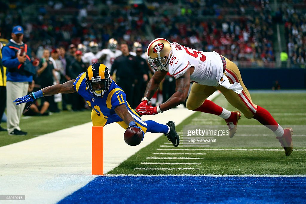 <a gi-track='captionPersonalityLinkClicked' href=/galleries/search?phrase=Tavon+Austin&family=editorial&specificpeople=6543303 ng-click='$event.stopPropagation()'>Tavon Austin</a> #11 of the St. Louis Rams scores a touchdown past <a gi-track='captionPersonalityLinkClicked' href=/galleries/search?phrase=Ahmad+Brooks&family=editorial&specificpeople=2326499 ng-click='$event.stopPropagation()'>Ahmad Brooks</a> #55 of the San Francisco 49ers in the second quarter at the Edward Jones Dome on November 1, 2015 in St. Louis, Missouri.