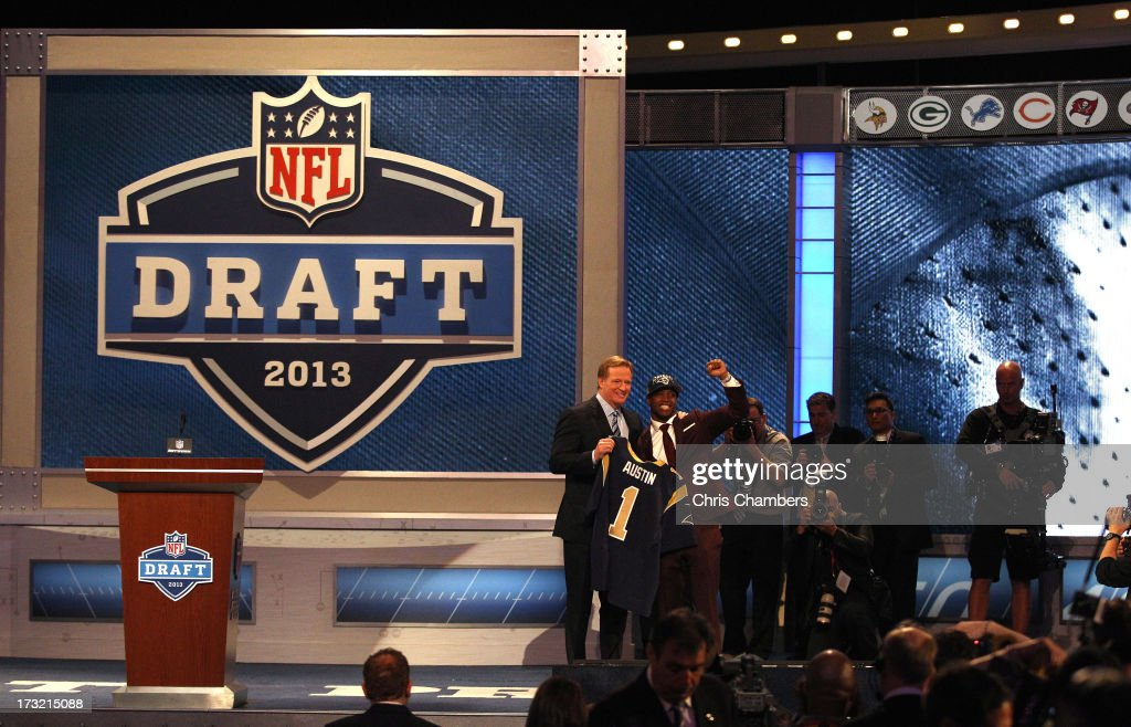 Tavon Austin (R) of West Virginia Mountaineers reacts with NFL Commissioner Roger Goodell as they hold up a jersey on stage after Austin was picked #8 overall by the St. Louis Rams in the first round of the 2013 NFL Draft at Radio City Music Hall on April 25, 2013 in New York City.