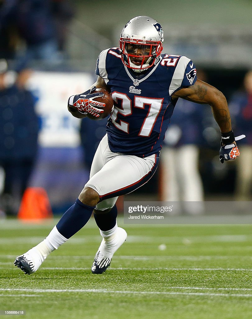 <a gi-track='captionPersonalityLinkClicked' href=/galleries/search?phrase=Tavon+Wilson&family=editorial&specificpeople=5633042 ng-click='$event.stopPropagation()'>Tavon Wilson</a> #27 of the New England Patriots runs with the ball after intercepting a pass from Andrew Luck #12 of the Indianapolis Colts during the game on November 18, 2012 at Gillette Stadium in Foxboro, Massachusetts.