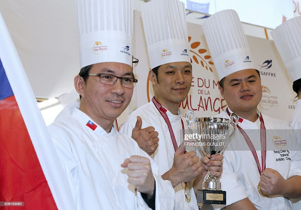 Tawain's team celebrates with their trophy after winning the second place during the Bakery world cup, as part of the Europain fair, on February 9, 2016, in Villepinte near Paris. / AFP / FRANCOIS GUILLOT