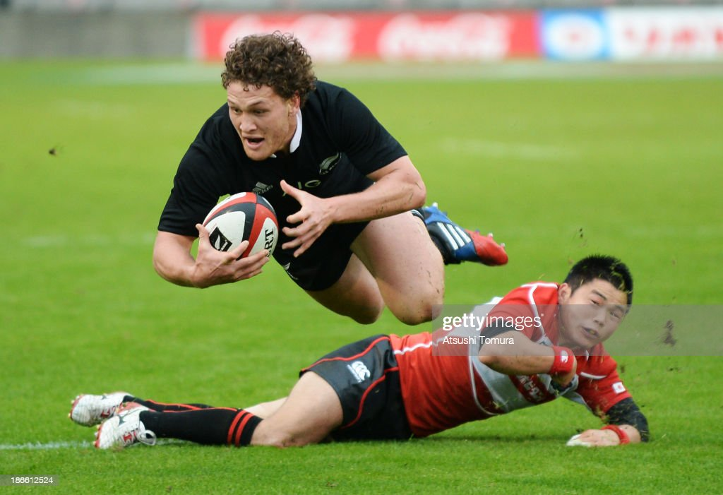 Tawera Kerr Barlow of New Zealand is tackled by <a gi-track='captionPersonalityLinkClicked' href=/galleries/search?phrase=Fumiaki+Tanaka&family=editorial&specificpeople=5409297 ng-click='$event.stopPropagation()'>Fumiaki Tanaka</a> of Japan during the International Rugby Test Match between Japan and the New Zealand All Blacks at Prince Chichibu Memorial Rugby Stadium on November 2, 2013 in Tokyo, Japan.
