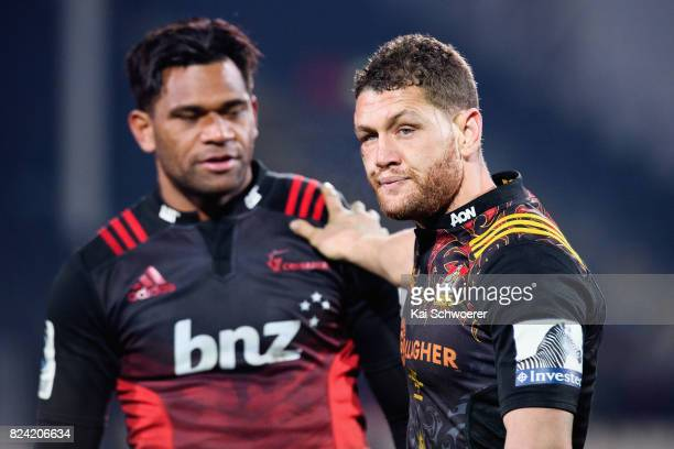 Tawera KerrBarlow of the Chiefs congratulates Seta Tamanivalu of the Crusaders following the Super Rugby Semi Final match between the Crusaders and...