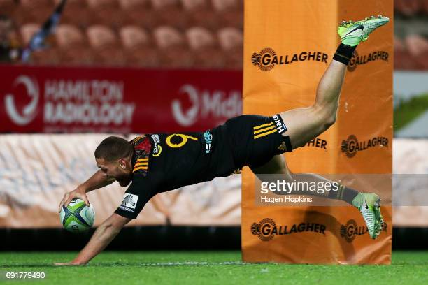 Tawera KerrBarlow of the Chiefs dives over for a try during the round 15 Super Rugby match between the Chiefs and the Waratahs at Waikato Stadium on...