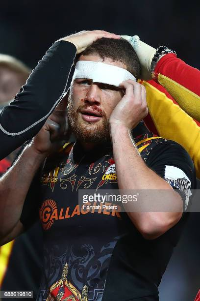 Tawera KerrBarlow of the Chiefs has his head strapped during the round 14 Super Rugby match between the Blues and the Chiefs and Eden Park on May 26...