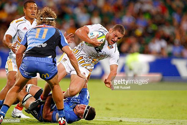 Tawera KerrBarlow of the Chiefs is tackled during the round six Super Rugby match between the Force and the Chiefs at nib Stadium on March 22 2014 in...