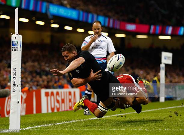 Tawera KerrBarlow of the New Zealand All Blacks is tackled short of the try line during the 2015 Rugby World Cup Quarter Final match between New...