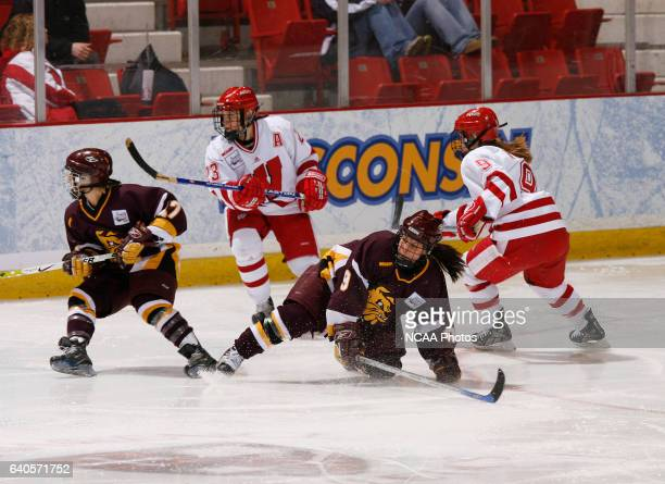 Tawni Mattila of the University of MinnesotaDuluth slides on the ice during the Division I Women's Ice Hockey Championship held at the Olympic Center...