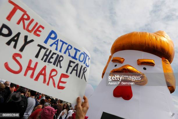 Tax Day demonstrators gather on the grounds of the US Capitol April 15 2017 in Washington DC Activists gathered in cities nationwide to demand...
