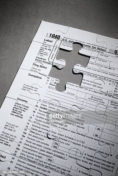 US tax form 1040 with jigsaw puzzle piece cut out