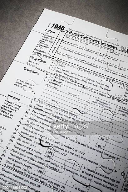 US tax form 1040 with pattern of jigsaw puzzle pieces cut out