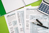 tax form, pen, note and calculator