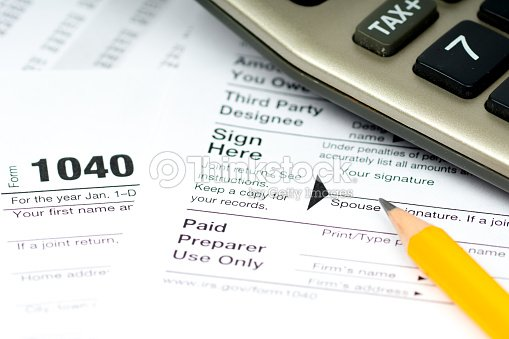 1040 tax form with calculator and pencil stock photo for 1040 tax table calculator
